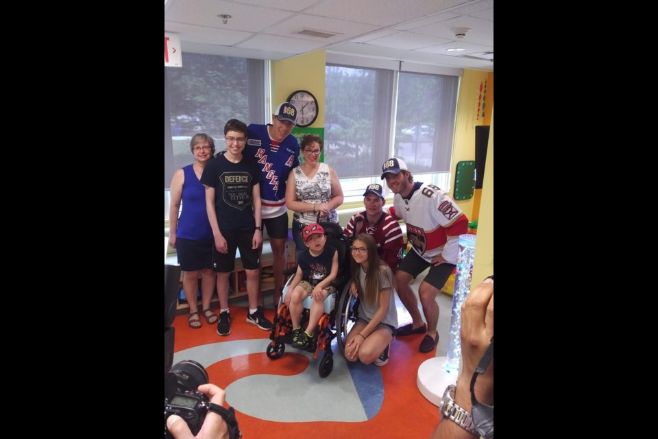 Mike Hoffman, Michael Latta and Logan Stanley visited with kids and families at Grand River Hospital on Wednesday afternoon. Photo credit: Grand River Hospital Foundation