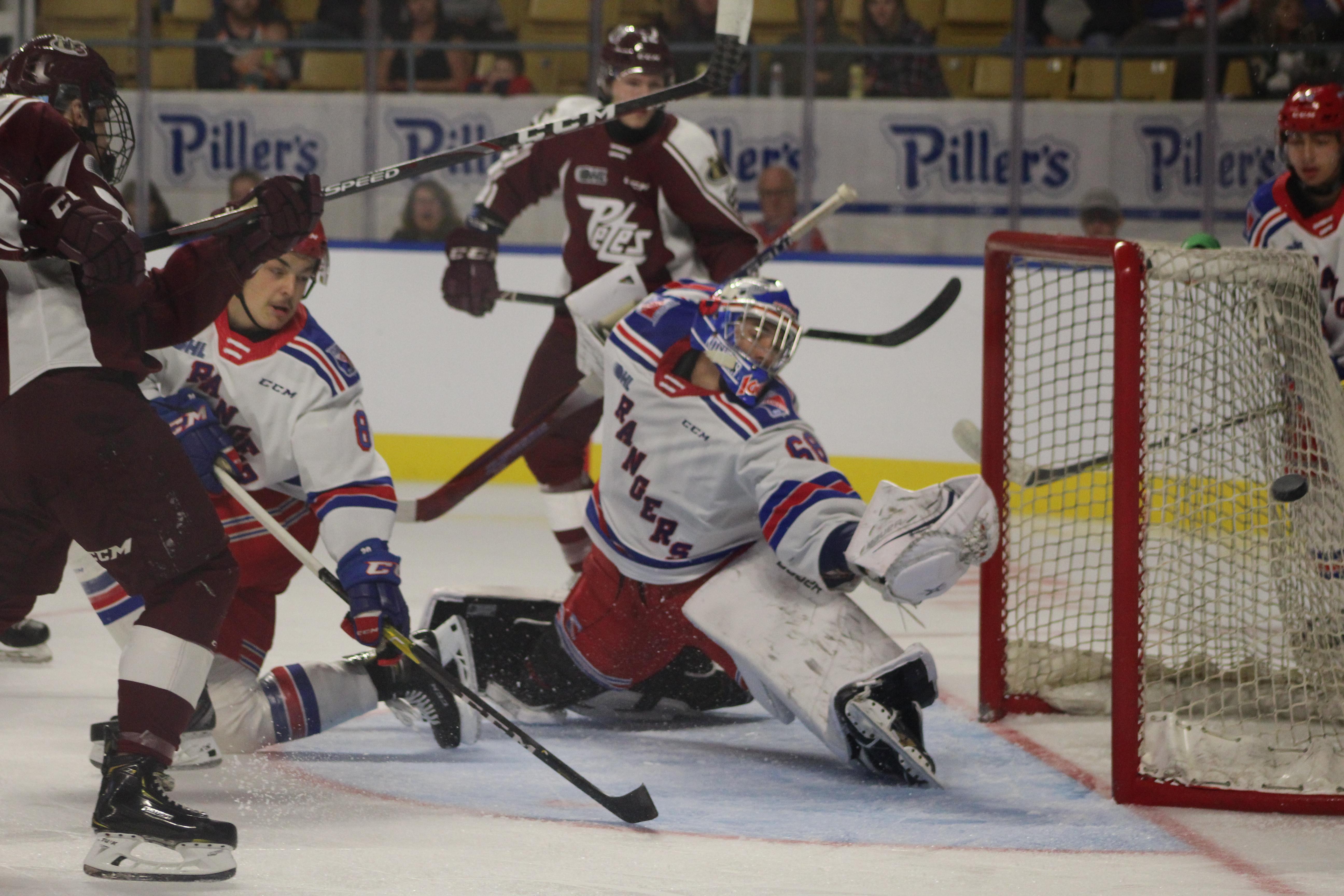 Rangers cap high-scoring showcase with shootout win