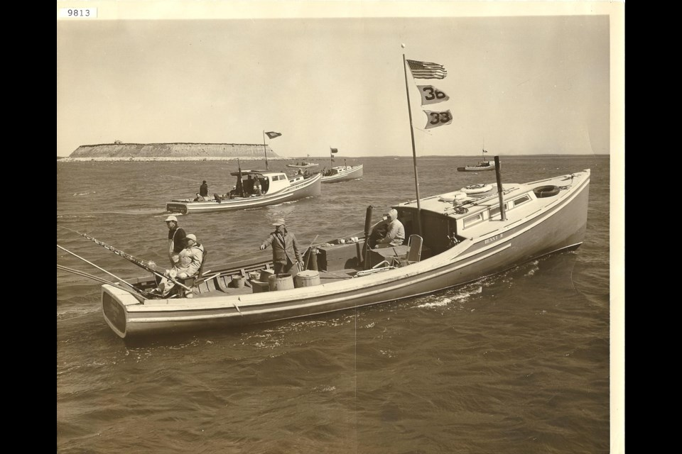 Outer Bald Island can be seen in the background as contestants fish for tuna in the mid-'50s. (Wedgeport Tuna Museum Archives)