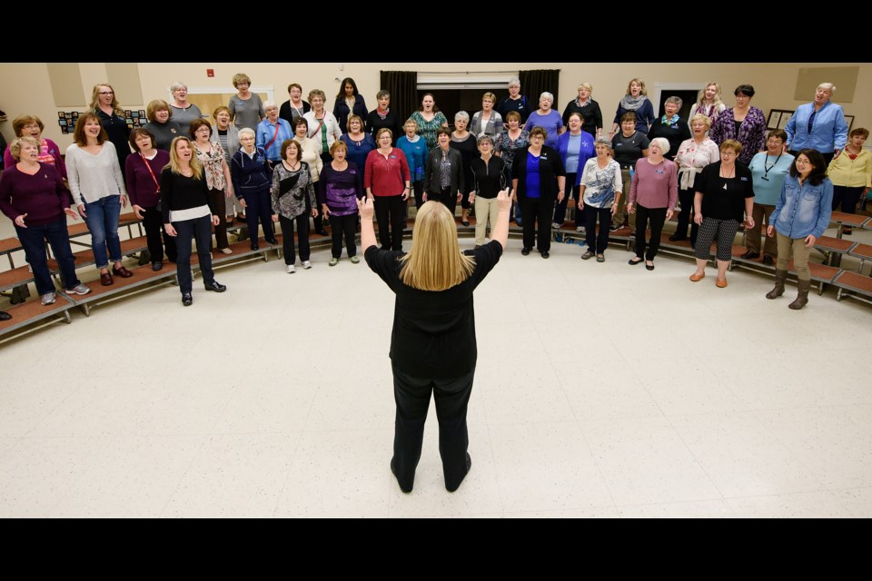 Members of the ScotianAires barbershop chorus rehearse at Trinity Anglican Church in Fairview. (CHRISTIAN LAFORCE / Local Xpress)