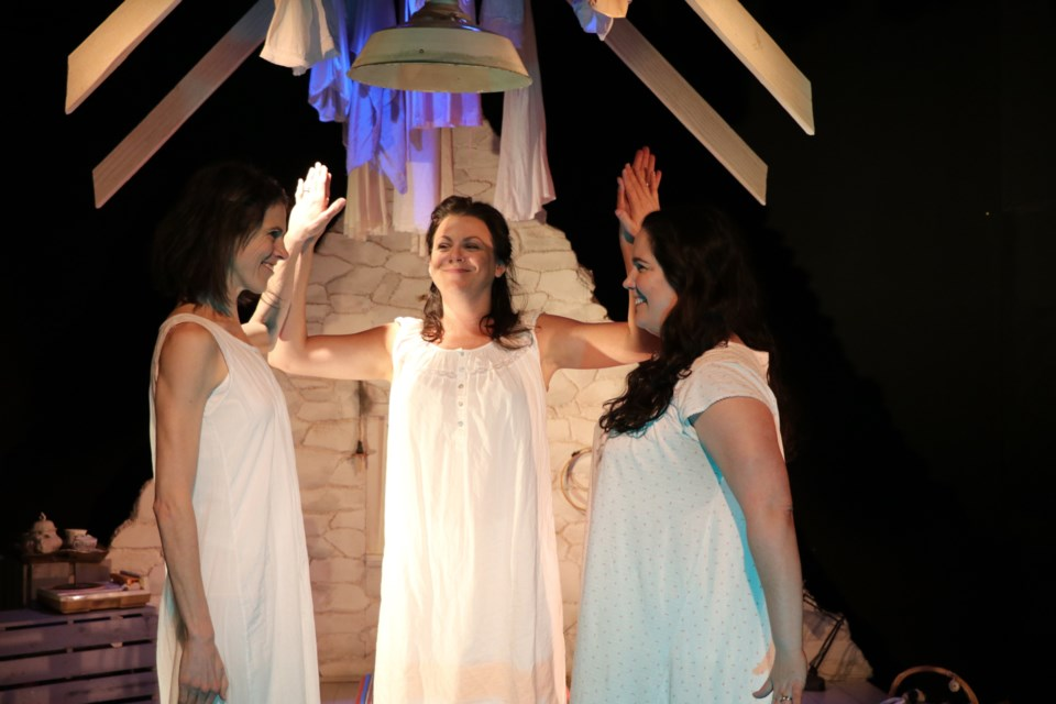 Geneviève Steele (Rosie), left, Francine Deschepper (Dunya) and Ryanne Chisholm (Annie) in a scene from the LunaSea Theatre production of The Donahue Sisters running through Saturday at The Waiting Room, Almon Street, Halifax. (ERIC WYNNE / LocalXpress)