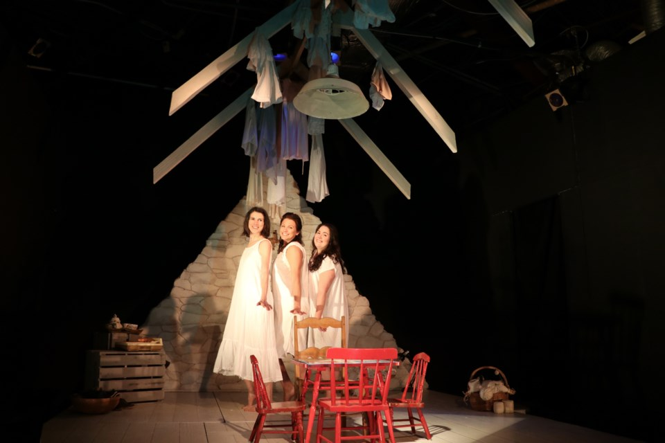 Geneviève Steele (Rosie), left, Francine Deschepper (Dunya) and Ryanne Chisholm (Annie) star in  LunaSea Theatre's production of The Donahue Sisters at The Waiting Room through Saturday. (ERIC WYNNE / LocalXpress)