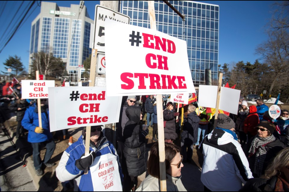 Halifax Typographical Union members and their supporters gather for a rally Monday in front of the Chronicle Herald building on Joseph Howe Drive.  (RYAN TAPLIN / Local Xpress)