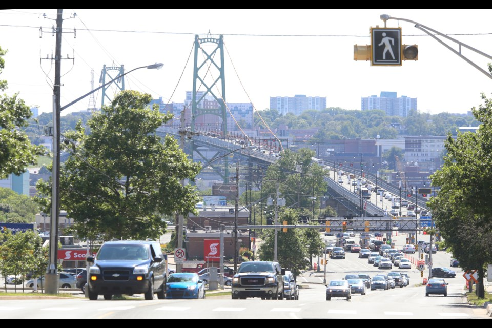 Rush-hour traffic funnels off the Macdonald bridge last week.