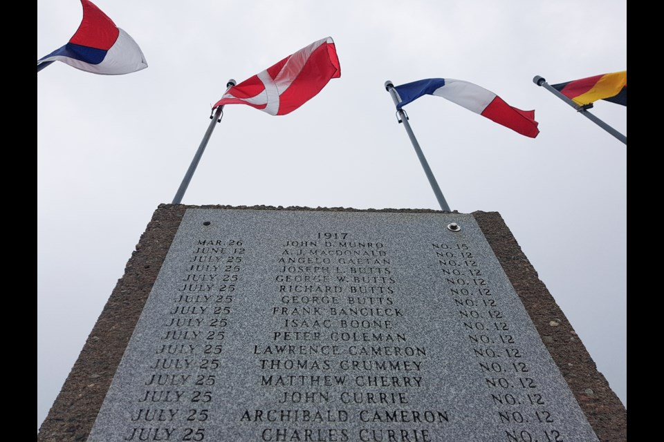 Monuments in New Waterford's Colliery Lands Park fly flags of the world and list the names of men and boys who died in Cape Breton coal mines, including 65 who died in the No. 12 Colliery explosion of July 25, 1917. (TOM AYERS / Local Xpress)