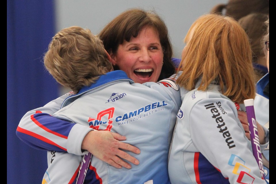 Mary Mattatall hugs teammates Jill Alcoe-Holland and Marg Cutcliffe after defeating the Jill Brothers rink to win the Nova Scotia women's curling championship in Halifax on Jan. 29.  (TIM KROCHAK / Local Xpress)