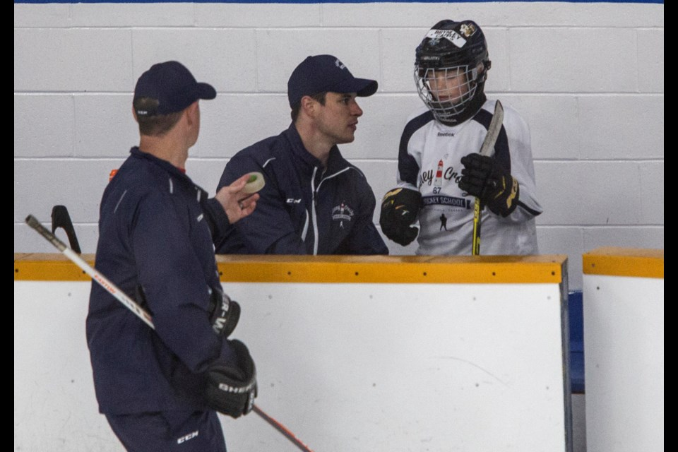 Sidney Crosby chats Wednesday with Brynley Capps, 8, of Chelmsford, Essex County, in the U.K. Brynley is one of Crosby's charges at his hockey school at Cole Harbour Place. Crosby was waiting to tape Brynley's stubborn hockey sock. (TIM KROCHAK / Local Xpress)