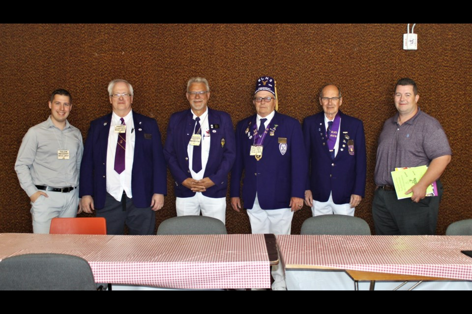 L-R: Talon Regent, chairman of the judiciary for the provincial Elks; Harold Claffey, provincial publicity director; Ron Potter, Grand Exalted Ruler; Eugene Hartter, current provincial president; Chris Svab, incoming provincial president; Kevan McBeth, executive director of Elks Canada.