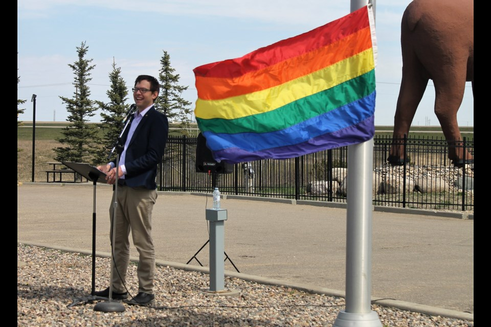Executive Director of Moose Jaw Pride Joe Wickenhauser, pictured here, asked each guest to give the flag a pull, to get it to the top of the pole. (Larissa Kurz photograph)