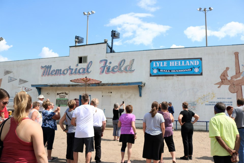 Gathering to admire the new sign. Photo by Scott Hellings