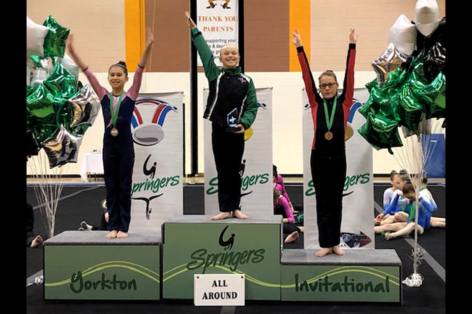 Shaina Closs (right) finished third overall in the Junior Olympics 7 division.