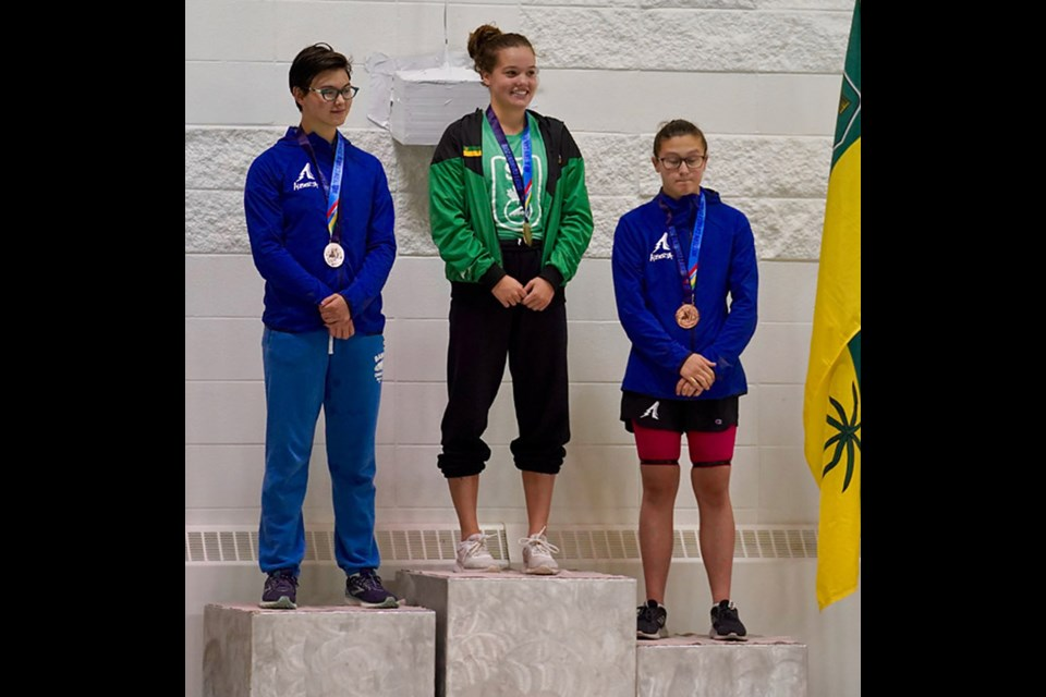 Cadence Johns on the podium after her gold medal win Saturday. 2019wcsg.ca photo