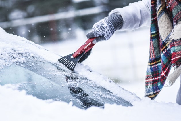winter scraping windshield stock