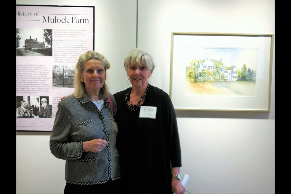 Shown at a reception marking the exhibit opening are Deborah Mulock Barbour (left), great great granddaughter of Sir William Mulock, and Linda Welch, president of the Society of York Region Artists. Supplied photo/Town of Newmarket