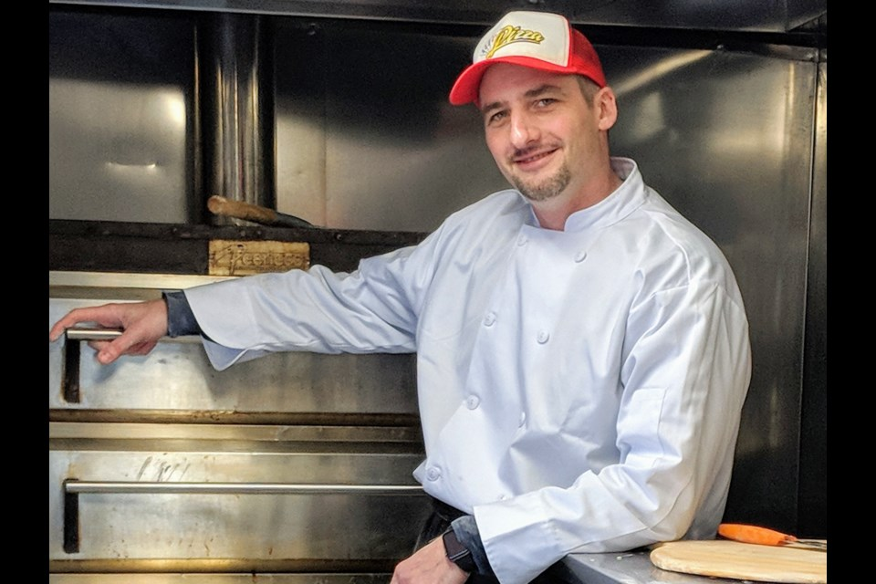 Pizza chef Akos Pataki, who runs A's Pizza Truck with his wife, Erika, this month celebrates the first anniversary of turning the truck into a full-time business. Kim Champion/NewmarketToday