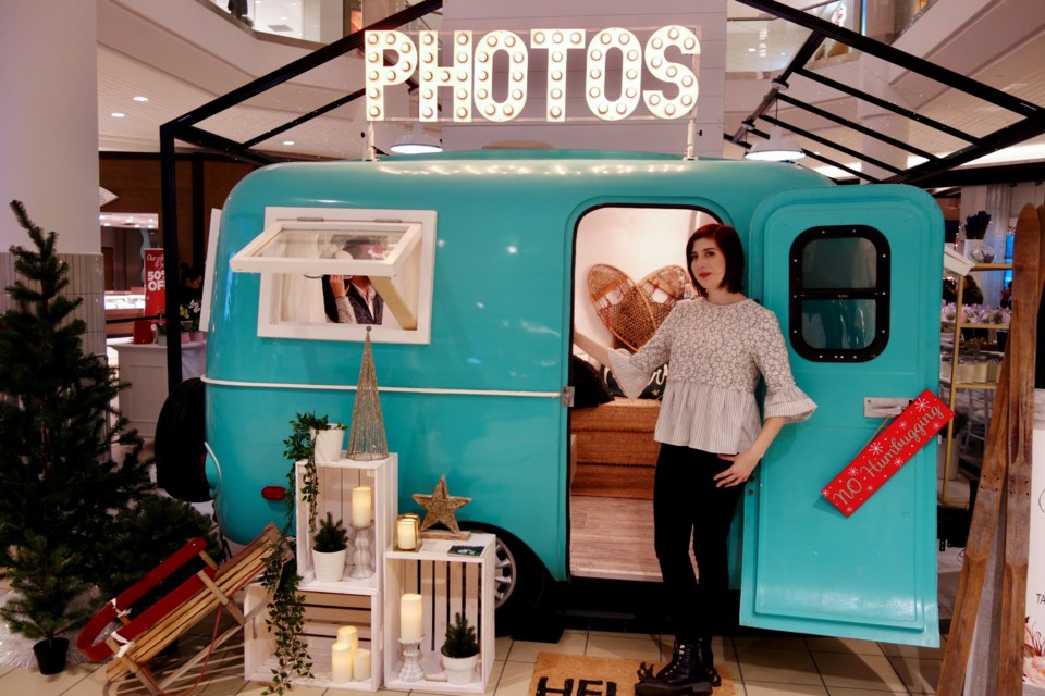 If you're too old to sit on Santa's lap for a photo, you can visit Chantalle Gallego at the Snaptique camper photo booth for a holiday postcard memento at the Merry Market at Upper Canada Mall until Dec. 24. Debora Kelly/NewmarketToday