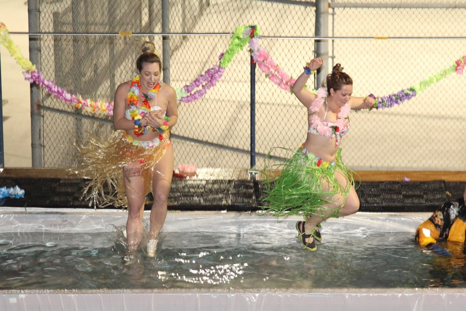 Anya Sitser and Amanda Masin froze their leis at the third annual York Regional Police Association Polar Plunge last night.  Greg King for NewmarketToday