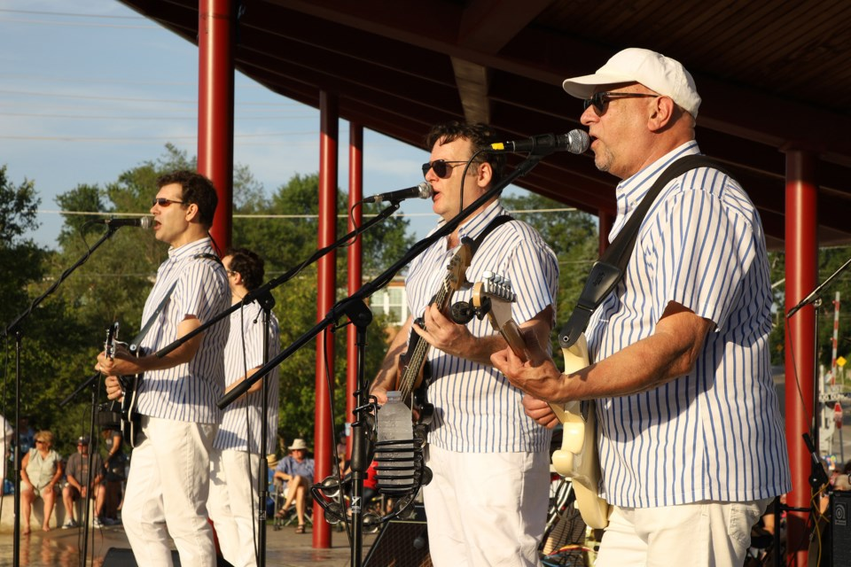 The Beach Party Boys, a Beach Boys tribute band, features Newmarket's own Jeff Scott (left) at Newmarket's TD Music Series last night at Riverwalk Commons.  Greg King for NewmarketToday