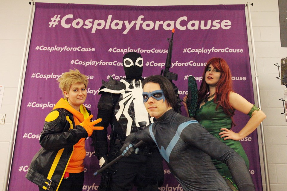 "Cosplayers Amanda Murray (Spark from Pokemon Go), Christian Perera (Agent Venom), Rogue Benjamin (Poison Ivy) and Scott Irvine (Night Wing) took part in #CosplayforaCause with donations going to Easter Seals at the Newmarket Card & Comics Show ""XL Edition"" yesterday at the Newmarket Community Centre. Greg King for NewmarketToday"