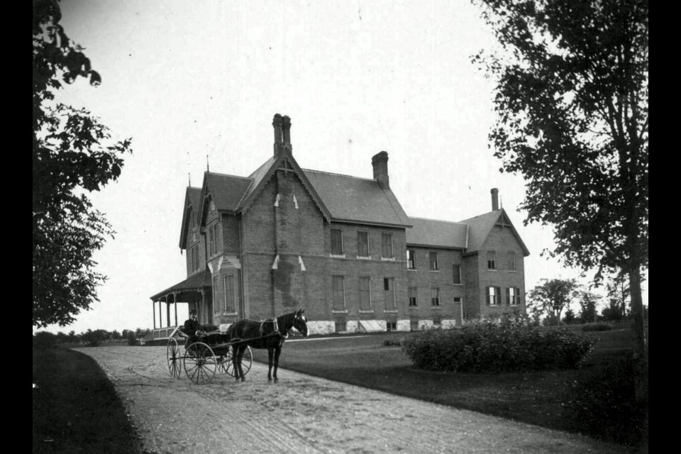 A stately view of the Mulock family home in this early 1900s photograph.