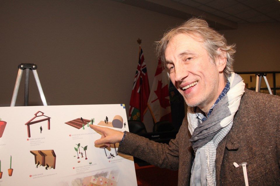 Designer Neno Kovacevic points out his favourite feature at the splash pad, a water maze that teaches children to work together while learning about local food through play. Greg King for NewmarketToday