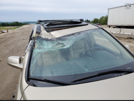 The driver of this vehicle travelling southbound on Highway 400 today was lucky not be injured when tires from a transport truck hit the passenger side of the front window. Supplied photo/OPP