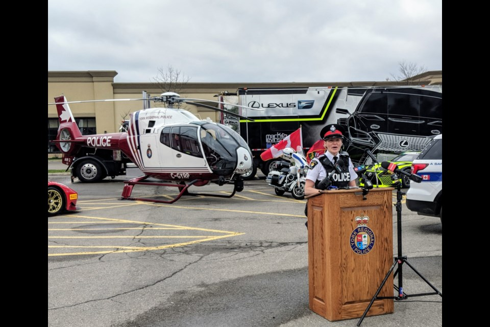 York Regional Police Staff Sgt. Sarah Riddell speaks May 10 at the kickoff of Project E.R.A.S.E. The York police Air2 helicopter is shown in the background. It is deployed to help catch street racers and stunt drivers. Kim Champion/NewmarketToday