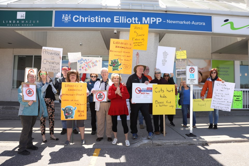 Protesters gathered in front of MPP Christine Elliott's constituency office.  Greg King for NewmarketToday
