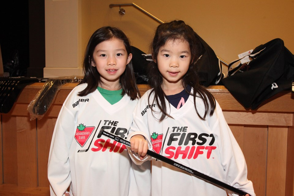 Sisters Clara and Emma Zhou get a fun introduction to hockey at the Canadian Tire First Shift last night at the Old Town Hall.  Greg King for Newmarket Today