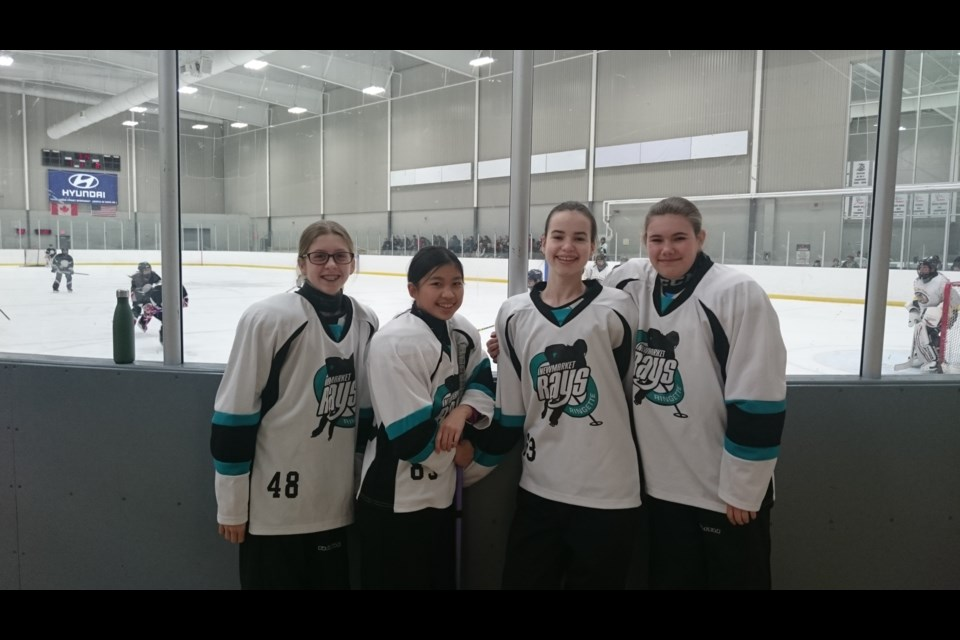 Newmarket Rays players (from left) Hailey Byers, Vanessa Cheung, Megan Brown, and Brynn Fenwick are shown here at the Ignite the Ice Ringette tourney in 2018. Supplied photo