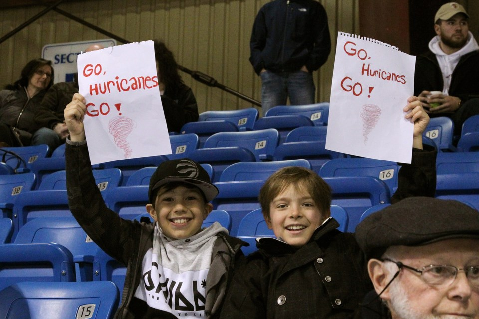 Young fans Preston Peddle and Ethan Taylor cheer on the Hurricanes during the playoffs.  Greg King for NewmarketToday