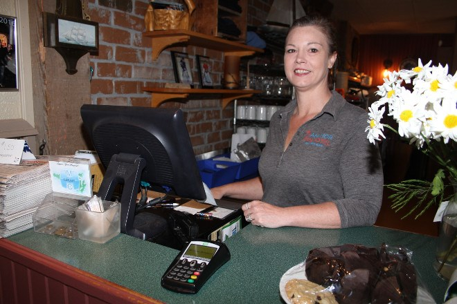 Denise Callaghan works the till in the dining area of the Anchor Inn. As of July 1 she and husband Chris are the new owners of the historic bar and restaurant. The couple purchased all the shares for the the business earlier this year from original owners Bruce and Kelly O'Hare and partner Rob Norris. Denise is a familiar face as a longtime employee and says she has no plans to make major changes to the menu or the business.