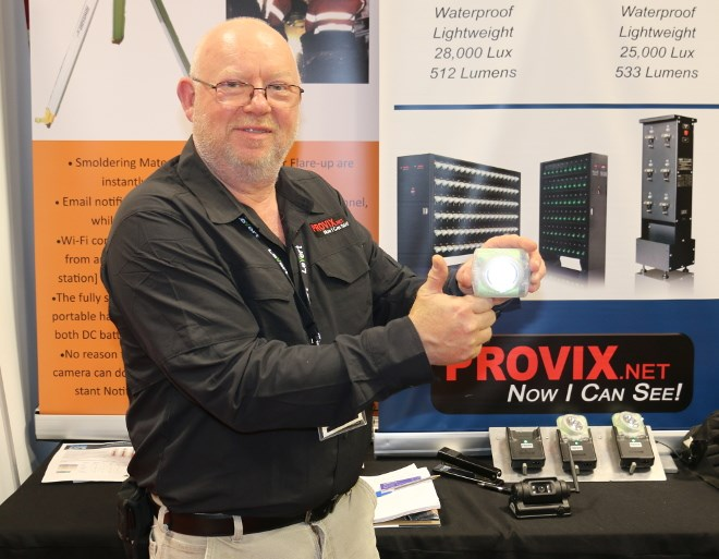 Provix president Dave Winfield displays his palm-sized cap lamp unit at the Big Event Mine Expo in Timmins. (Len Gillis photo)