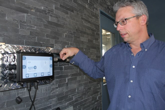 David Ballantyne, vice-president of product development, with a Plexus Powernet, which is currently running a lighted sign in Maestro Digital Mine's office in Lively. The system uses copper coaxial cable, the same kind that used in cable TV and Internet transmissions, as a durable and efficient way to get data from the mine face to the command centre.