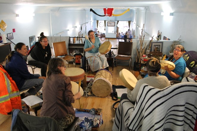 Cindy Crowe, right, seated on the couch, drumming, leads a drum circle I the loft of Blue Sky  Community Healing Centre while a Learn to Paint class does on on the main floor of the Victoria Avenue centre. Crowe also is the proprietor of One Tribe Indigenous Worldview and Diversity Coaching to help businesses and government agencies have a better understanding of First Nations cultures. The centre and services, Crow says, are being well received and helping to attract businesses back tot he south end downtown core.