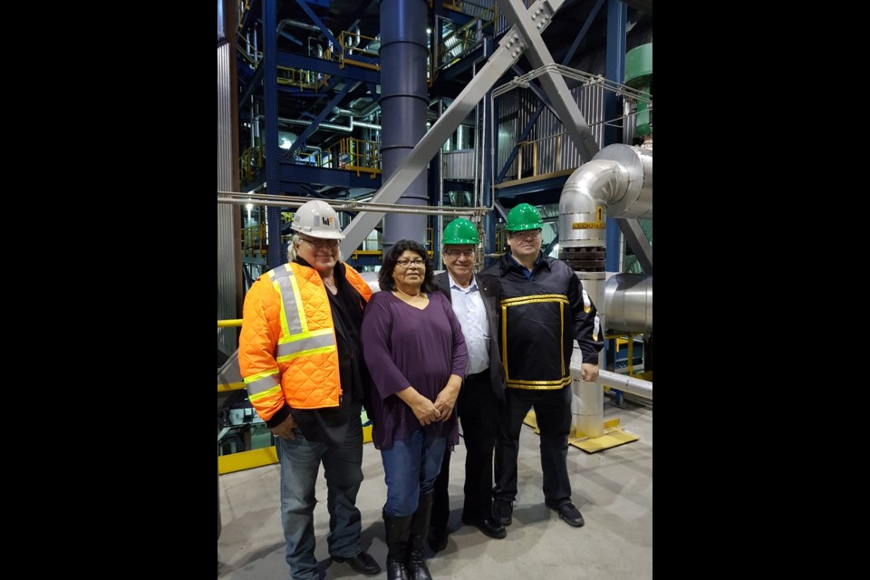 Chief Keith Corston of the Chapleau Cree First Nation, Chief Johanna Desmoulin of the Netamisakomik Anishinabek (Pic Mobert First Nation, Frank Dottori, President and CEO of Hornepayne Lumber and Hornepayne Power Inc., and Chief Jason Gauthier of the Missanabie Cree First Nation,  tour the Hornepayne co-gen facility.  (Nadine Robinson photo)
