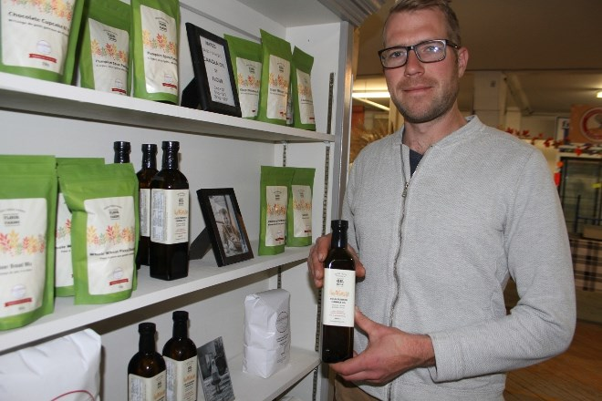 Jeff Burke at his kiosk at the Thunder Bay Country  Market on Oct. 24, where he sells a wide range of products, including flour, cake mixes and his own canola oil.