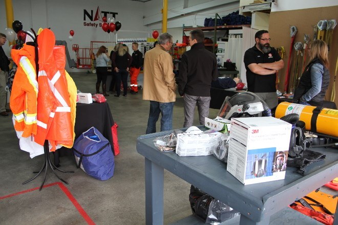 Members of the public and well-wishers packed the office of NATT Safety Services to celebrate the official grand opening in Lively in October, which included demonstrations of confined space rescues, looking over equipment they use, touring parts of the facility and talking to staff.