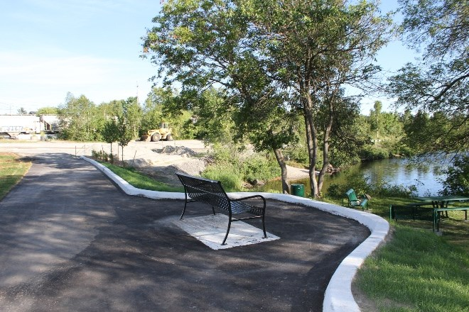 In Capreol, on the south end of Lakeshore Street, is a seating area and picnic tables, as well as the start of a paved walkway along Vermillion River. All of which are part of the $1.8 million in improvements to the riverfront to attract visitors.