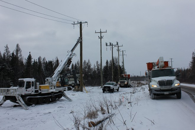 PowerTel connects the first pole to the distribution system.(Opiikapawiin Services LP photo)