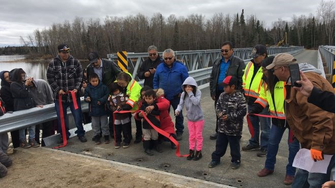 North Caribou Lake First Nation community members gathered at the new bridge crossing the Weagamou Lake narrows to mark the opening of a new bridge that will give the community year-round access. (NAN photo)