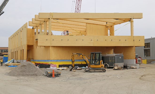 Mass timber construction uses engineered wood products such as cross-laminated timber and glue-laminated timber to build larger structures. (Ontario Wood WORKS! photo)
