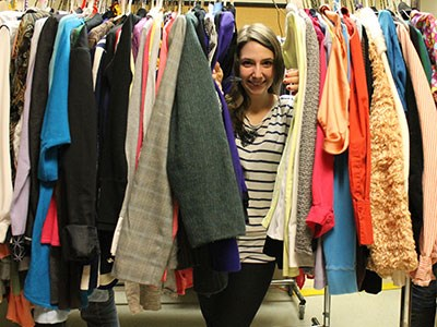 498459a3357 Cambrian College student Melissa Rotella peeks through a rack of clothing  at the school s Professional Clothing Depot