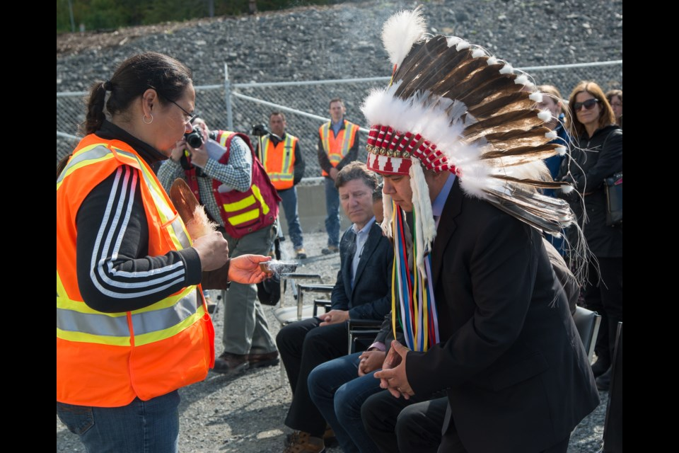 Taykwa Tagamou Nation Chief Dwight Sutherland participates in a smudging ceremony during a celebration of the opening of the Peter Sutherland Sr. Generating Station on Aug. 24. (Photos courtesy of Ontario Power Generation)