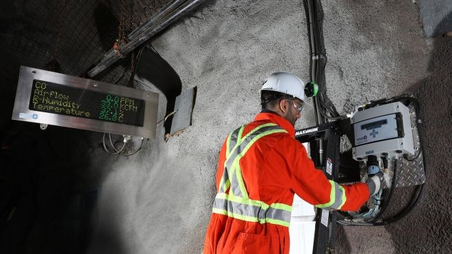 A technician works on a Vigilante AQS™ system installed in a mine. The system was developed as an answer to the logistical and technical problems ultra-deep mining brings to ventilation by making it completely self-contained, light, less expensive and easy to monitor.
