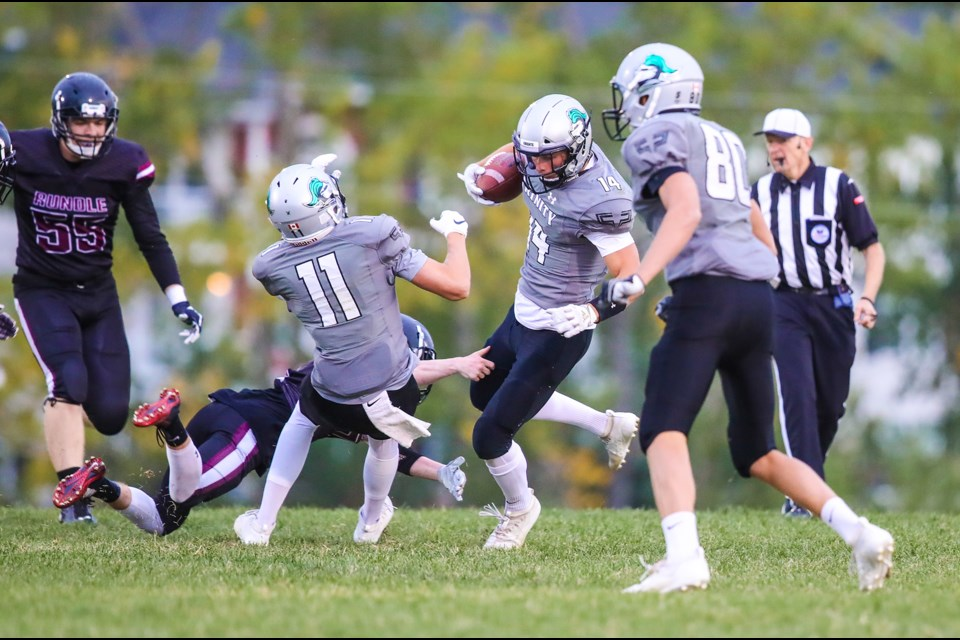 HTA Knight Noah Gutek makes a catch in traffic with younger brothers Jack Gutek (11) and Luke Gutek (80) nearby during the 41-0 win over Rundle College, Sept. 6 at Knights field. (BRENT CALVER/Western Wheel)