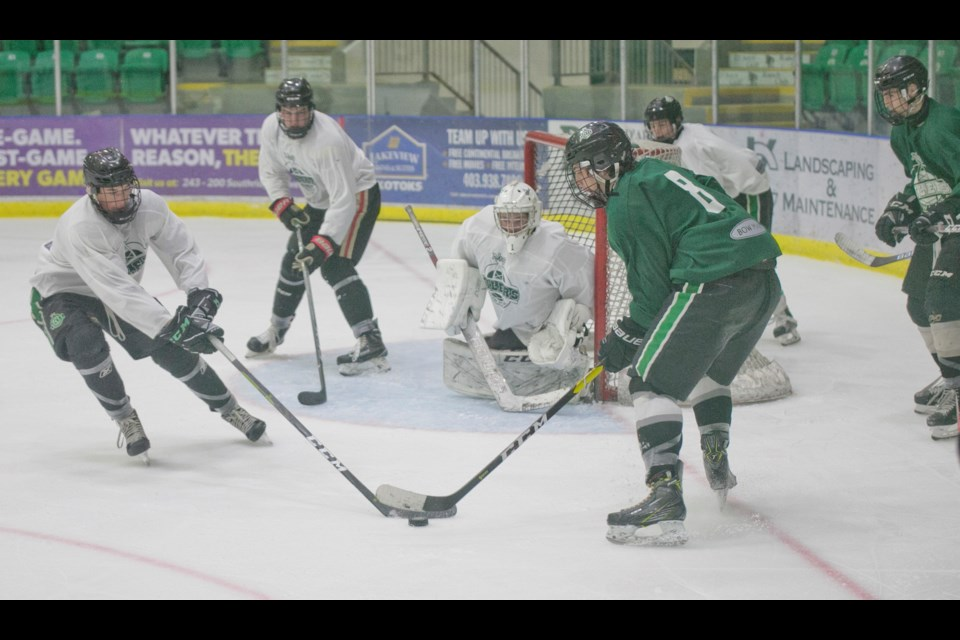 Okotoks Bow Mark Oilers prospects Hayden Schmidt, left, and Ethan McIntyre battle in front of goal during the Green & White Game on Sept. 7 at Pason Centennial Arena. (Remy Greer/Western Wheel)