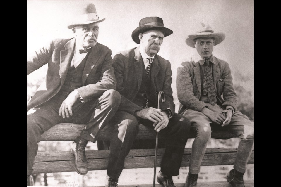 Edward, Prince of Wales, sitting on a corral fence with Archie McLean and George Lane at the Bar U Ranch in 1919. (Photo courtesy of the Museum of the Highwood)