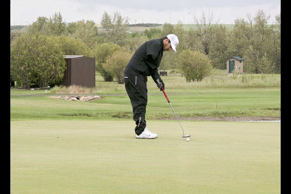 One-armed Jesse Florkowski of Medicine Hat lines up a putt en route to winning the Canadian Amputee and Disabled Golf championship Aug. 14-16 at River's Edge Golf Club. (Bruce Campbell/Western Wheel)