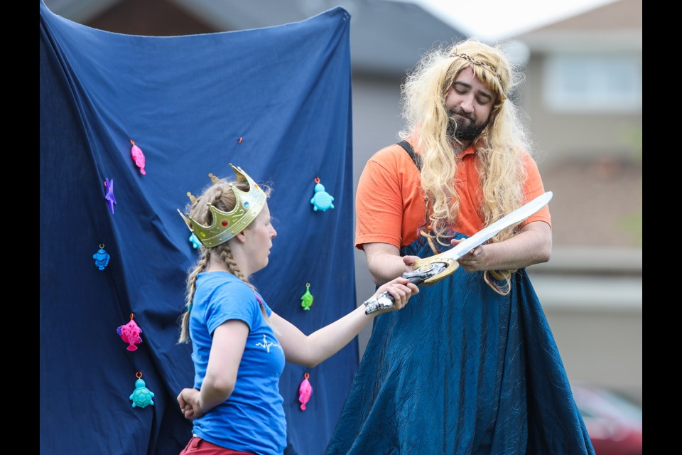 The Lady of the Lake (played by Alan Johnson) bestows a magical sword unto King Arthur (Kelly Malcolm) in Win the Warrior: A King Arthur Tale by Goodger Pink Family Theatre on July 6. (BRENT CALVER/Western Wheel)